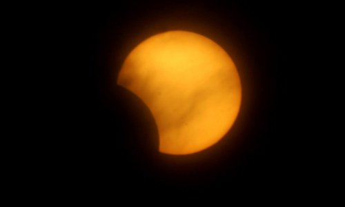 Solar eclipse will partially obscure the sun Thursday