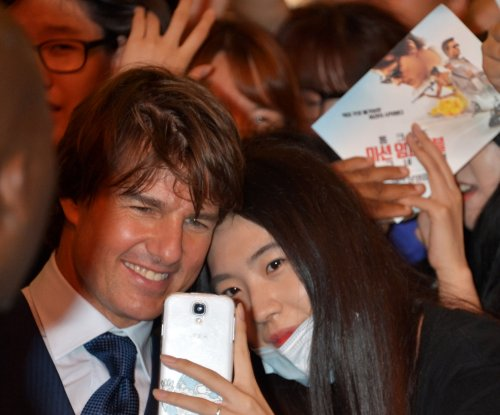 Tom Cruise woos South Korean moviegoers in Seoul