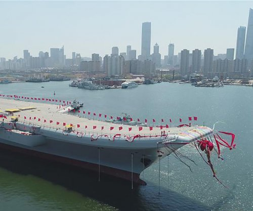 China adds to naval force with domestic aircraft carrier