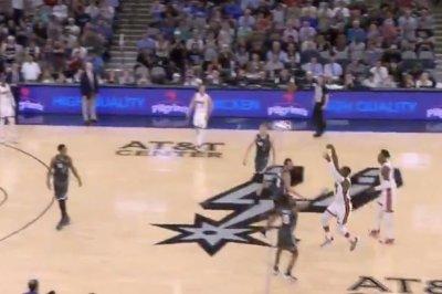 Heat's Dwyane Wade sinks half-court buzzer-beater