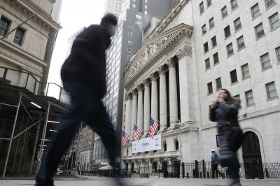 Dow erases early losses to climb to record; S&P and Nasdaq fall