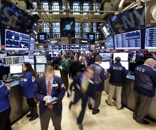 Crude oil prices slide on last day of 2014