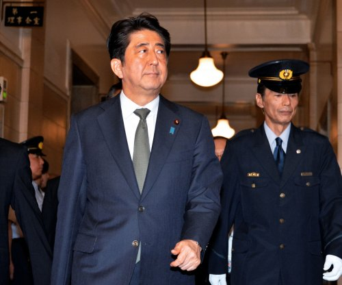 Japanese lawmakers clash over controversial security bill