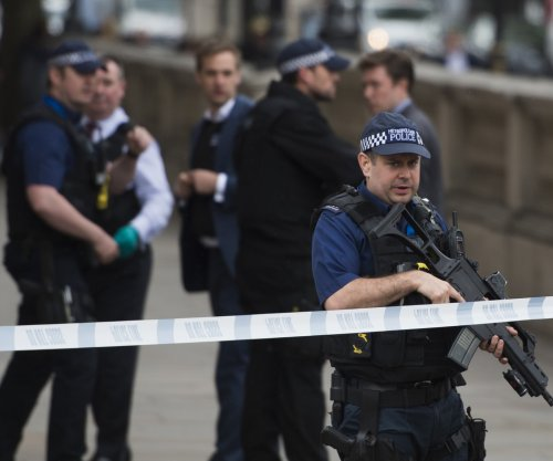 London police shoot woman, arrest six in counter-terror raid
