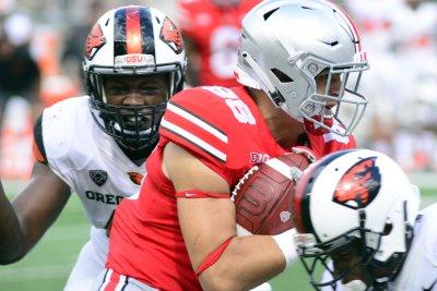 College Football Roundup: Minus Meyer, Buckeyes put on air show