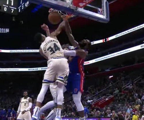 Pistons' Andre Drummond dunks all over Giannis Antetokounmpo