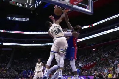 Pistons' Andre Drummond dunks all over Giannis Antetokounmpo