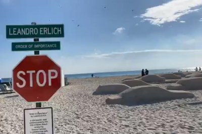 Artist creates life-sized traffic jam in sand of Florida beach