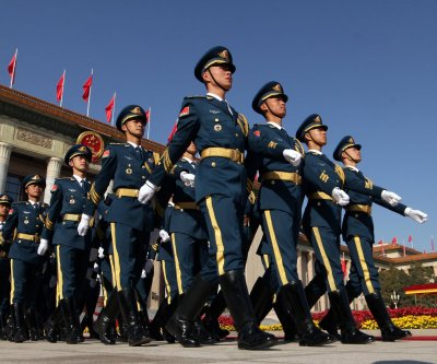 Experts: China seeking to normalize military presence beyond borders