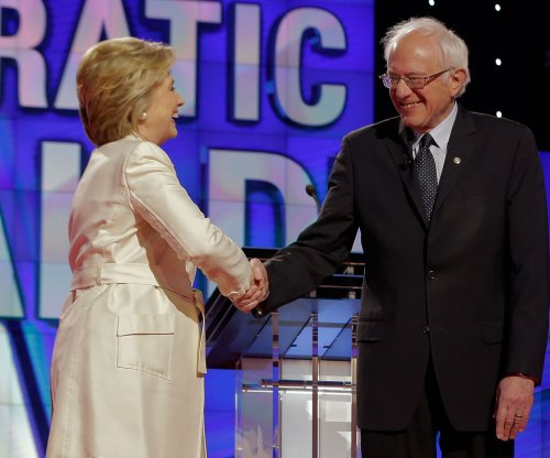 Clinton's judgment, Sanders' Wall Street plan questioned in New York debate