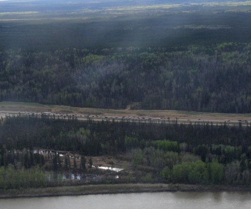 Fire threat to Alberta oil sands easing
