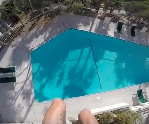 Stunt jumper in Laguna Beach, Calif., completes breathtaking plummet into hotel pool