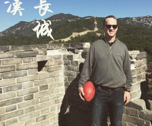 Watch: Peyton Manning toboggans Great Wall of China