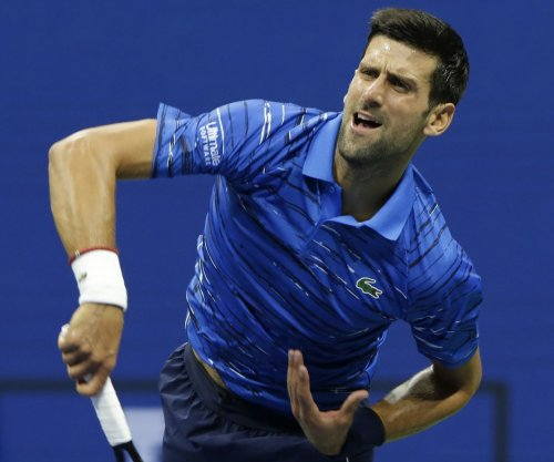 Novak Djokovic, Simona Halep win Italian Open titles
