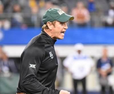 Baylor fires two aides to former coach Art Briles