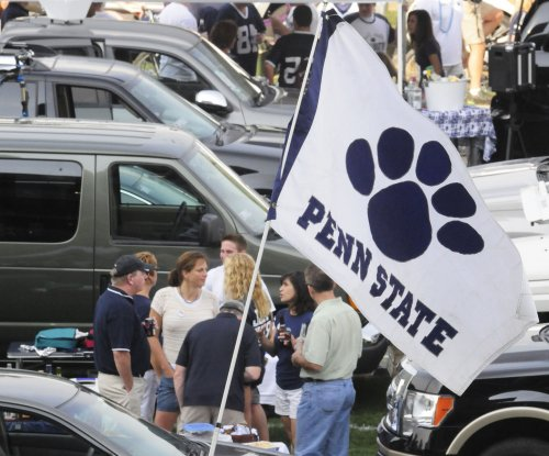 Grand jury says Penn State failed to protect pledges, calls for stronger hazing laws