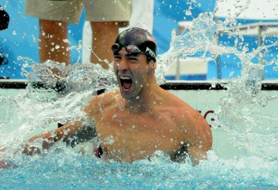 Phelps posts magical seventh Olympic win