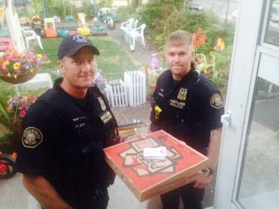 Portland police deliver pizza after delivery man is injured in car crash