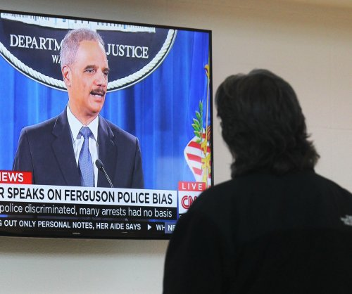 Holder: Will disband Ferguson Police Dept. if necessary