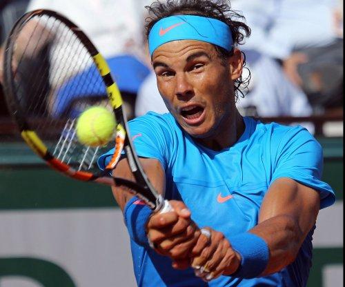 Rafael Nadal advances, David Ferrer upset in Qatar