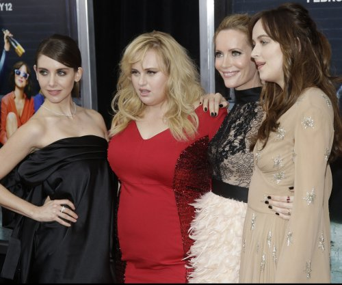 Rebel Wilson, Dakota Johnson attend 'How To Be Single' premiere
