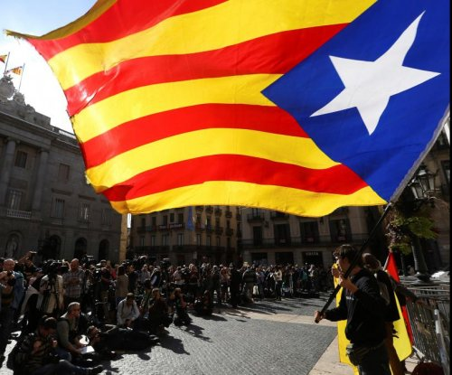 Ex-Catalan president takes refuge in Belgium under threat of charges