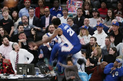 Sixers' Joel Embiid flies into stands, jumps over actress Regina King