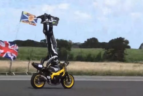 Stunt rider breaks Guinness record for fastest motorcycle headstand