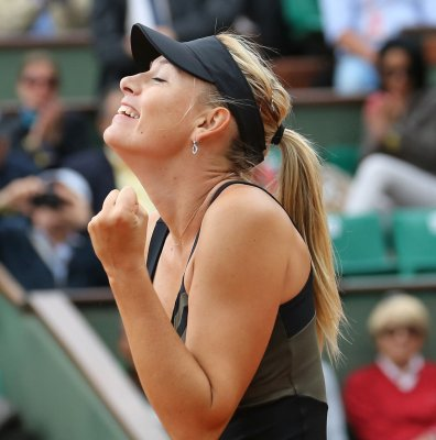 Williams, Sharapova roll into Italian Open quarterfinals