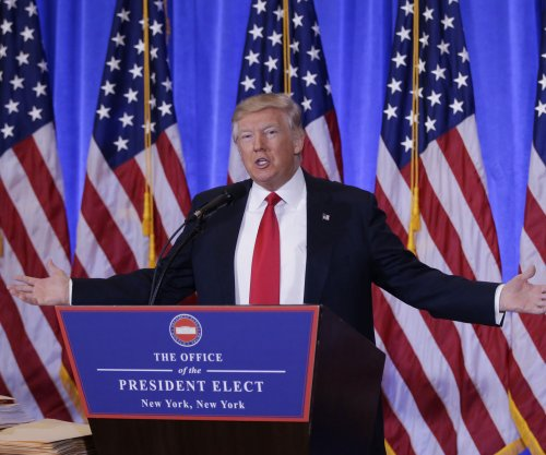 Donald Trump to place business holdings in blind trust run by sons
