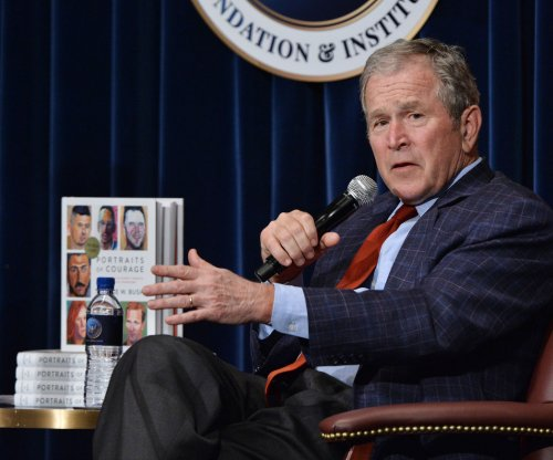 George W. Bush opens veterans portrait gallery, debuts book