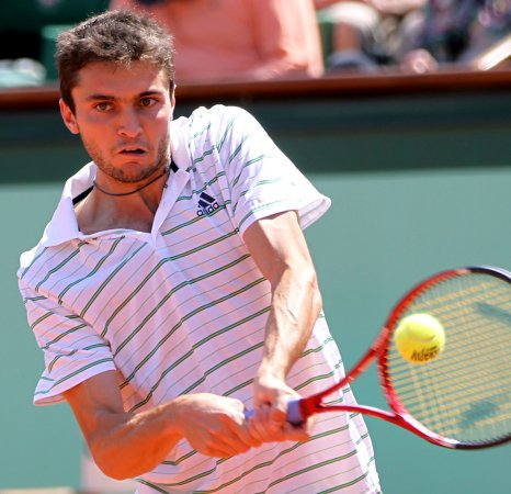 Simon advances, Tipsarevic loses in Romania