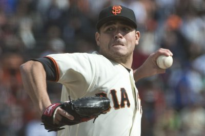 Matt Moore, Buster Posey help San Francisco Giants wrap up wild card