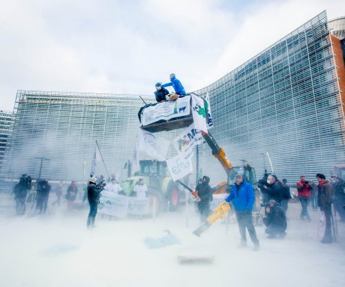 Farmers spray powdered milk on EU buildings in protest