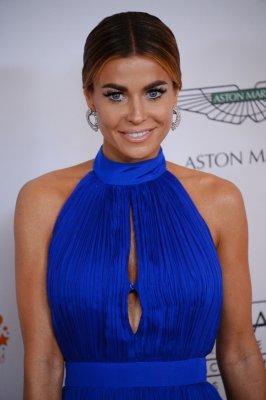 Carmen Electra stuns in swimsuit spread for Galore magazine
