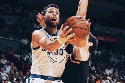 Stephen Curry, Golden State Warriors breeze past Miami Heat