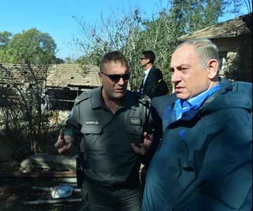 Israel arrests 22 in suspicious fires, classifies them 'terrorism'