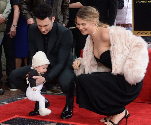 Behati Prinsloo, baby Dusty Rose make Adam Levine star-dedication ceremony a family affair