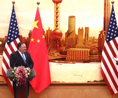 Trump approves $50B in Chinese tariffs; Beijing retaliates