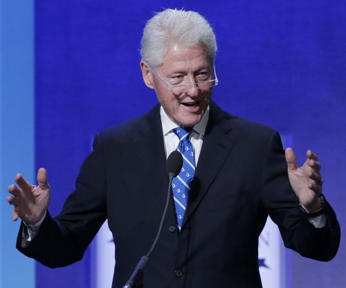 Bill Clinton calls Obamacare 'crazy system' during campaign stop