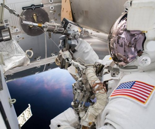 Astronauts back in space station after installing cameras during 6.5-hour spacewalk