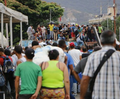 Venezuelans face crime, coronavirus at Colombia's closed border