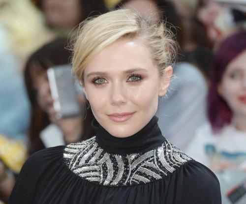 Elizabeth Olsen accidentally flashes underwear in Paris
