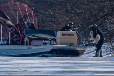 Watch:-Dog-rescued-after-four-days-stranded-on-Detroit-River-ice