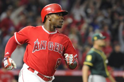 Angels' Upton homers on first pitch of season