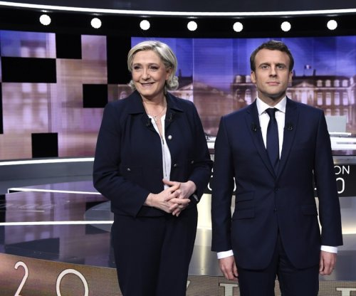 Le Pen, Macron bring out the barbs in French presidential debate
