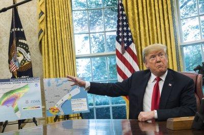 Trump says he will travel to Florida next week to survey hurricane damage