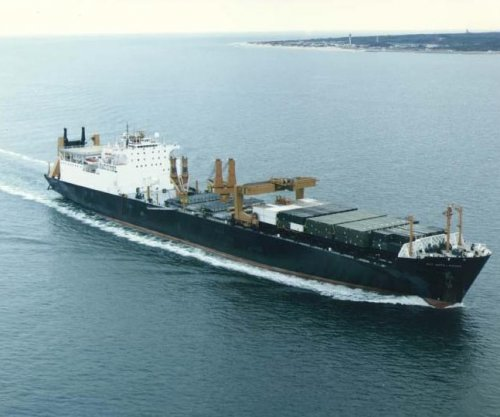 U.S. Navy vessel stuck on coral reef off Okinawa
