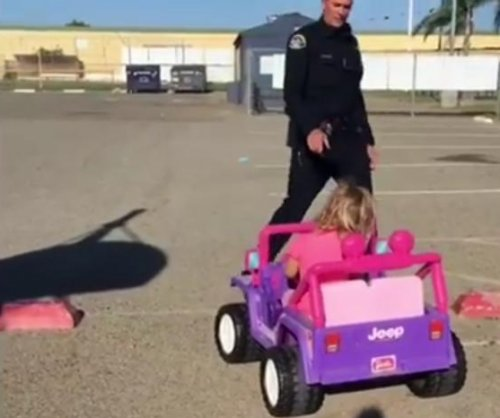 Girl, 3, gets 'warning' for driving Barbie Jeep with no license