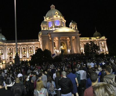 Thousands in Serbia protest new COVID-19 restrictions